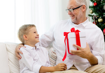 smiling grandfather and grandson at home