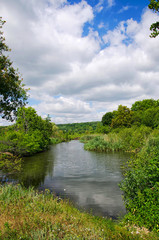 Summer landscape with a river and clouds
