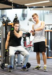 men exercising on gym machine