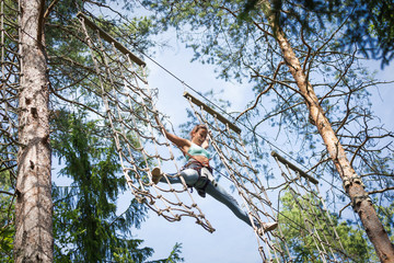 Brave woman in adventure rope park