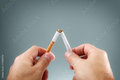 Breaking a cigarette - 71898156