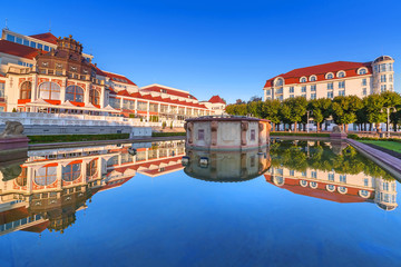 Baltic architecture of Sopot reflected in the fountain, Poland