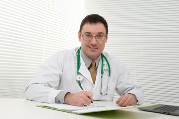 doctor using his laptop computer