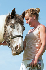 Portrait of young woman & her horse