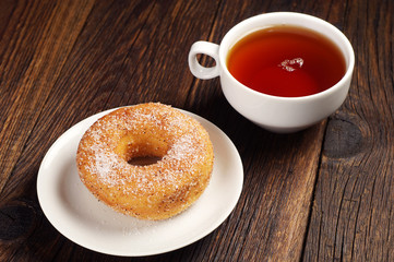 Tea cup and donut