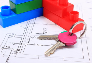 Home keys and building blocks on drawing of house
