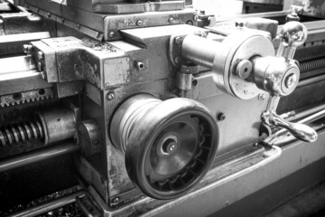 Black and white photograph of flywheels slide lathe