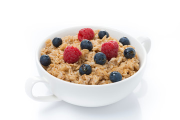 oat porridge with berries in a bowl, isolated