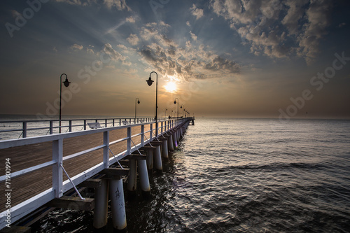 Sunrise on the pier at the seaside, Gdynia Orlowo,