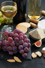 snacks - grapes, cheese and wine, close-up