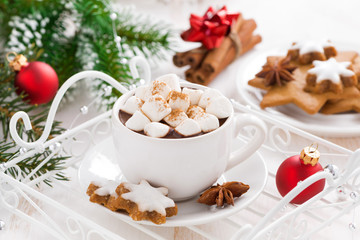 spicy hot chocolate with marshmallows and Christmas decorations