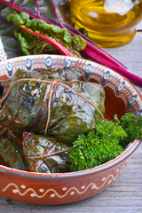 Stuffed chard leaves in ceramic bowl