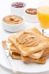 toast with various jams and peanut butter, orange juice