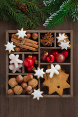 wooden box with Christmas symbols and spruce branches, top view