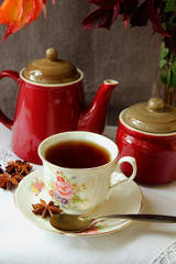 Teapot, sugar bowl and a cup of hot tea.