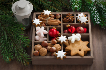 wooden box with Christmas symbols and spruce branches