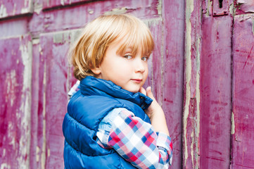 Portrait of adorable toddler boy outdoors on a street