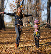 Young mother and her girl in autumn park