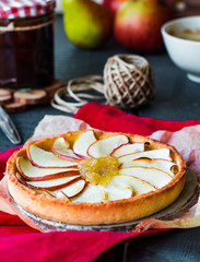 apple tart on a sand base with pear jam and caramel