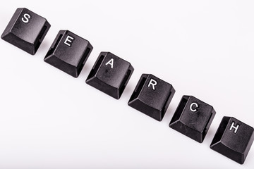 text search formed with computer keyboard keys on white backgrou