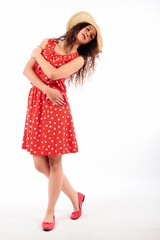 The girl in red polka dot dress with hat