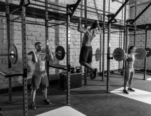 Barbell weight lifting group weightlifting at gym