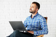 Casual man working with laptop