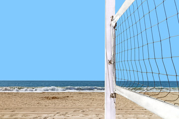 Close up of beach volleyball net mounted wood post