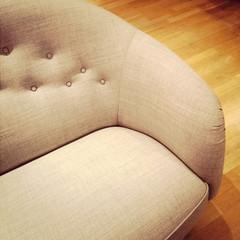 Fashionable sofa on wooden floor