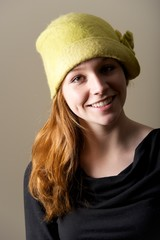 Smiling redhead with dimples in green hat