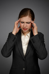 Businesswoman with strong migraine