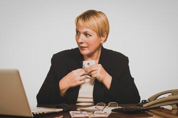Mature businesswoman hides money