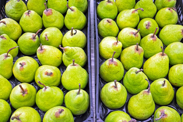 Green pears for sale at a market