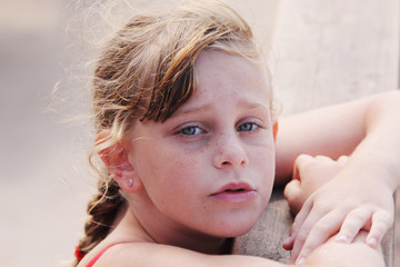 outdoors portrait of freckled cute girl