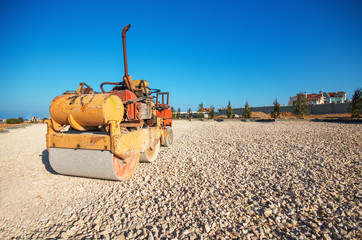 Old Roller (paver) and blue sky