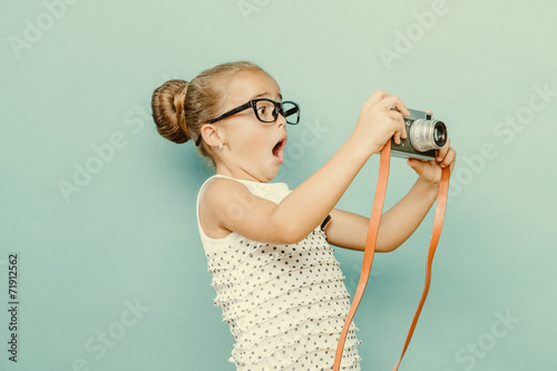 child holding a instant camera - 71912562