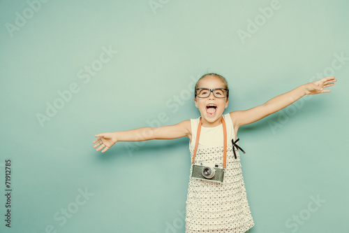 child holding a instant camera - 71912785