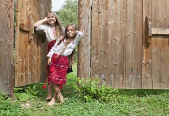 Sisters outside home