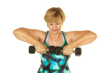 Mature Woman Lifting Weights on White Background