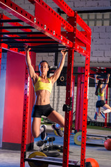 toes to bar woman pull-ups 2 bars