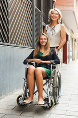 Happy woman in wheelchair  outdoor