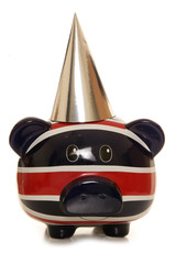 Piggy bank wearing silver party hat