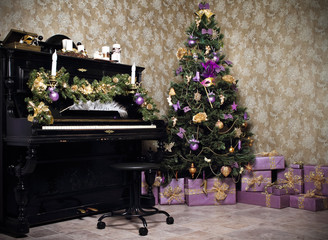 Vintage room with a piano, Christmas tree, candles, gifts  or pr