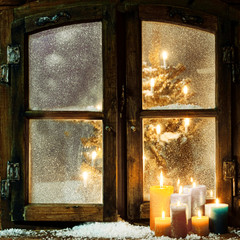 Welcoming Christmas window in a log cabin