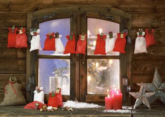 Christmas Sacks, Candles and Stars at Window Pane