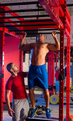 Toes to bar man pull-ups personal trainer