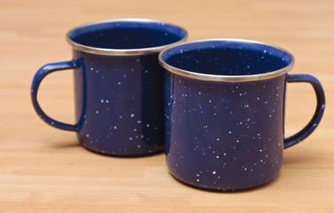 Two enamel mugs