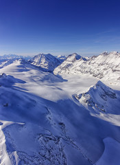 Valley and mountain ridge in Jungfrau region helicopter view in
