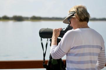 Mature woman birdwatching