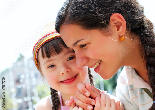 Happy family moments - Mother and child have a fun. - 71917709